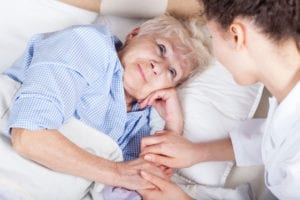 Nurse Tenderly Caring for Elderly Patient